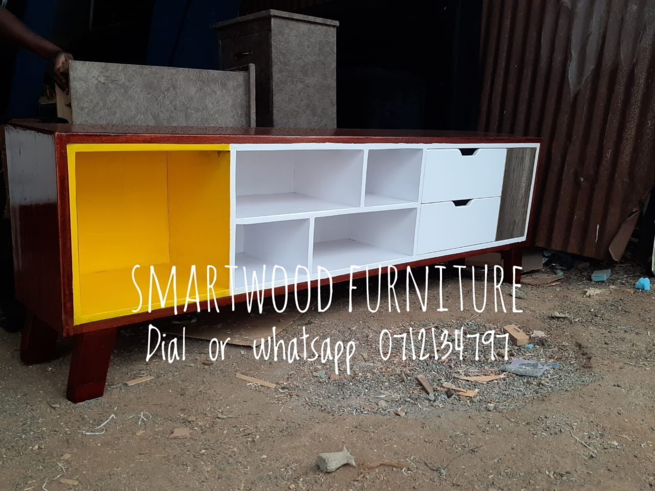 classy brown and yellow tv stand with 2 drawers and 6 open shelvies